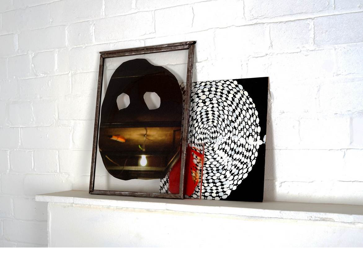 Mask, acrylic on digital print on canvas in a metal frame, 42 cm x 29 cm, 2009, Circle necklace, acrylic on MDF, 30 cm x 30 cm, 2009, and red palette, 12 cm x 9 cm, 2008. Image credit: Thierry Bal